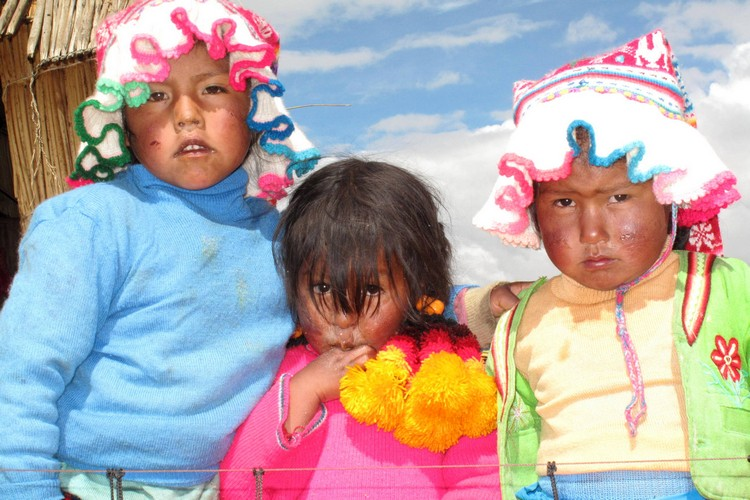 Photo of Uros children, floating islands, Lake Titicaca, Peru, South America