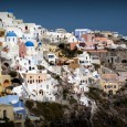 This week's travel photo capture's the stunning architecture of Oia, an old Greek village that's literally built into the volcanic cliffs of the island of Santorini
