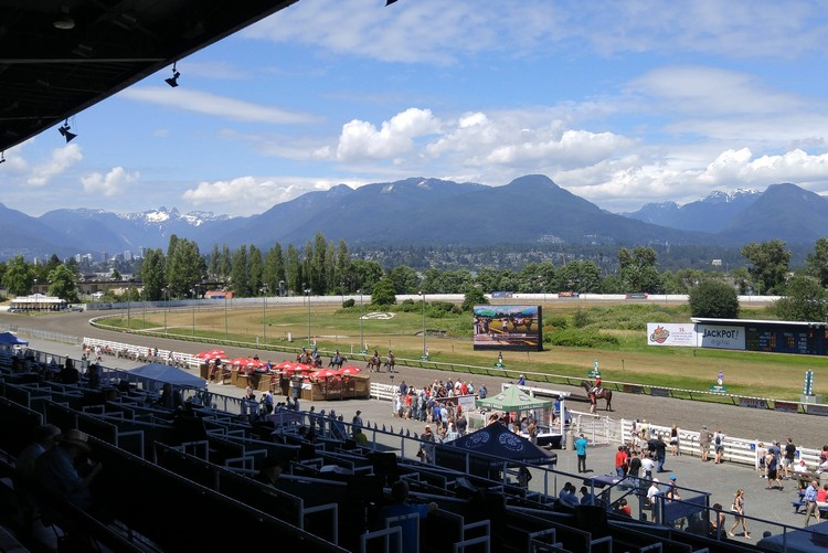 Hasting Park racecourse in East Vancouver, view of the track and North Shore mountains