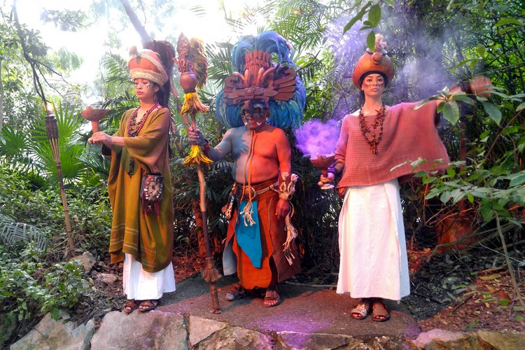 Maya actors at Xacret Night show, entertainment at Xcaret theme park, family travel guide