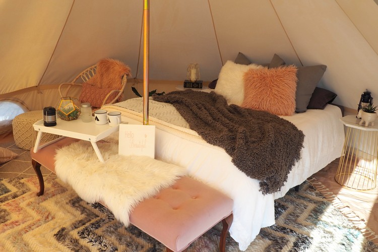 Inside tent, bed, Glamping in Kelowna at Unique Canvas Luxury Camping
