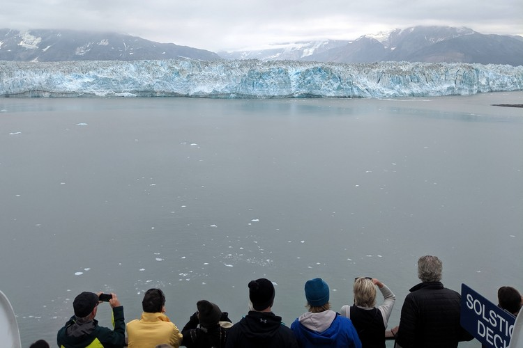 Guest viewing the Hubbard Glacier in Alaska on Celebrity Eclipse Alaska Cruise