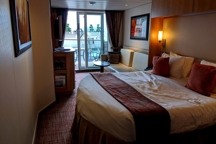 view inside Celebrity Eclipse stateroom with balcony