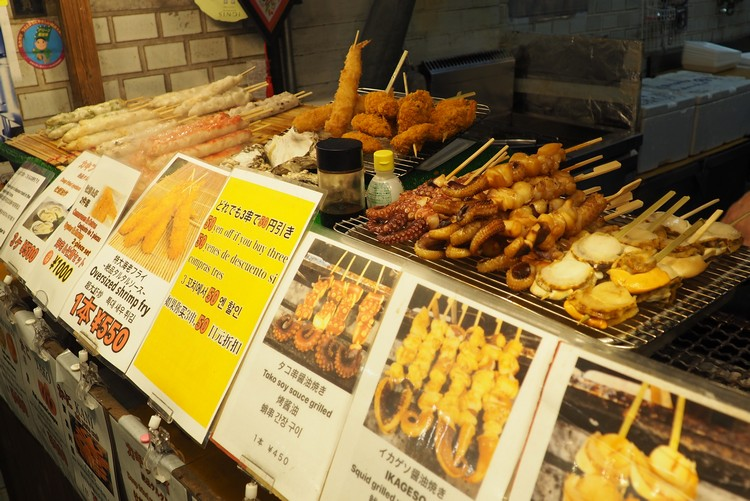 yakitori food vendor at Nishiki Market in Kyoto. Beginners guide to food in Japan for tourists