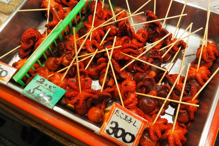 The popular red octopus on a stick at the popular Kyoto market, Nishiki Market interesting food to try in Kyoto