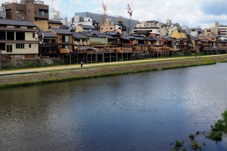 homes and buildings on the Kamo River in Kyoto Japan