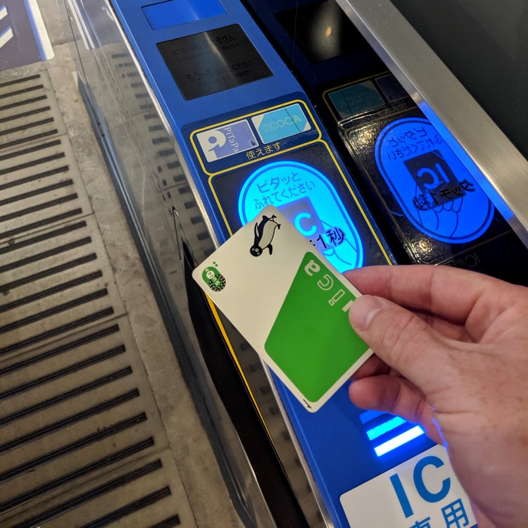 how to use Suica card at train stations in Tokyo Japan