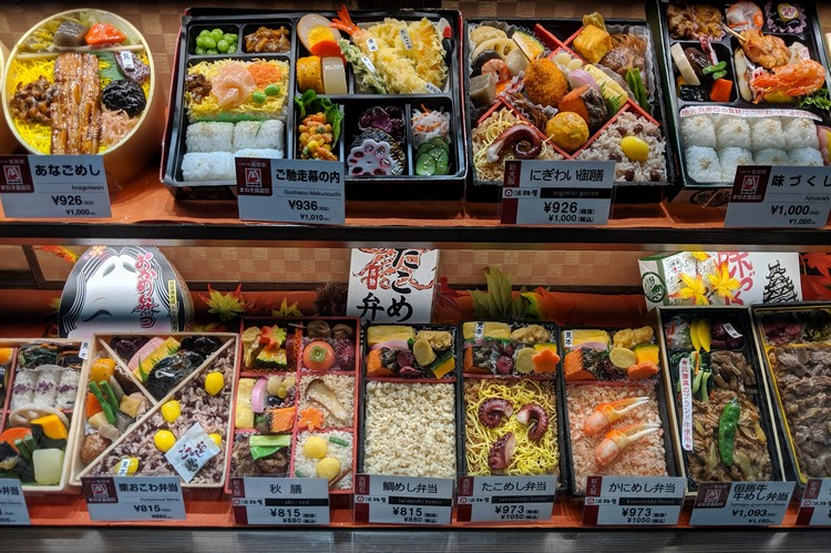 Japan travel tips - food display bento box and sushi to go at train station