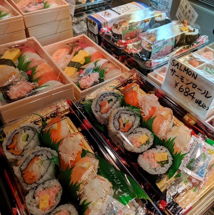 Variety of prepackaged sushi rolls and nigiri combos at the Kyoto train station. Beginners guide to Japanese food in Japan
