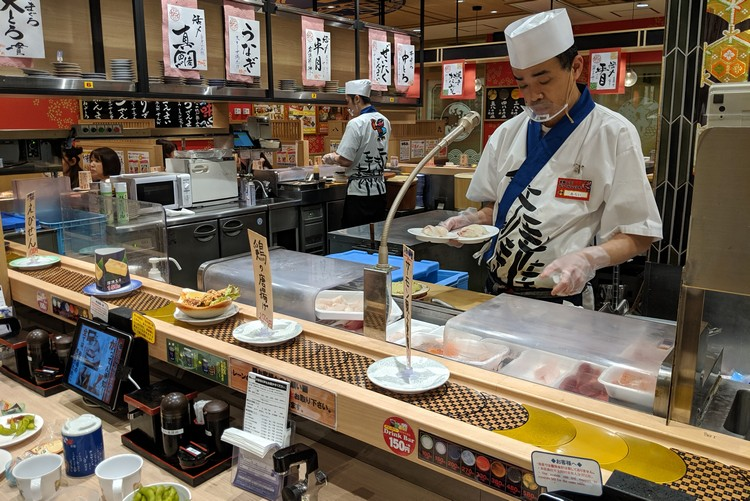 Beginners Guide to Food in Japan for first time visitors. Sushi restaurant in Kobe Japan