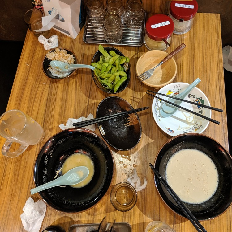 photo of empty bowls of Japanese food at Tokyo restaurant