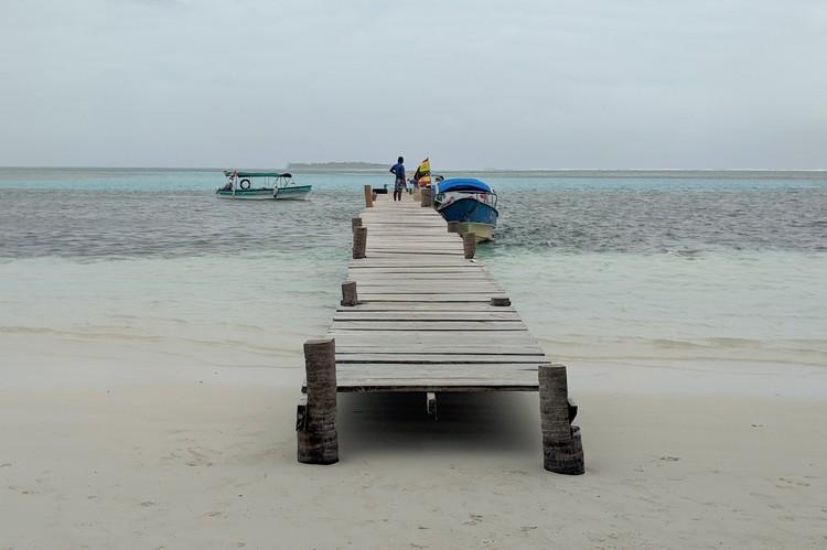 dock on the beach at Yanis Island in San Blas Islands Panama