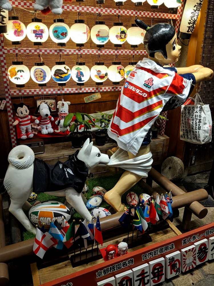 funny statue of boy with pants down at restaurant in Gion Kyoto. Okonomiyaki restaurant with boy statue in Kyoto