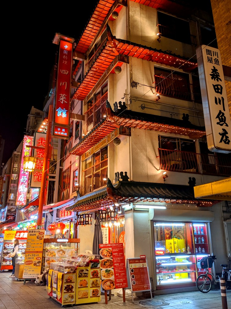 Kobe Chinatown buildings at night. Traditional Chinese Architecture in Kobe. night street photograph