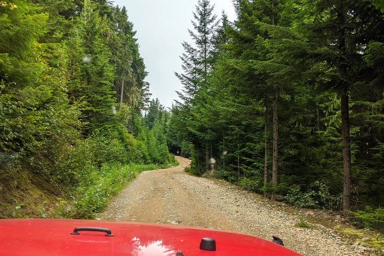 Driving on rocky road on Whistler Jeep Tour with Canadian Wilderness Adventures