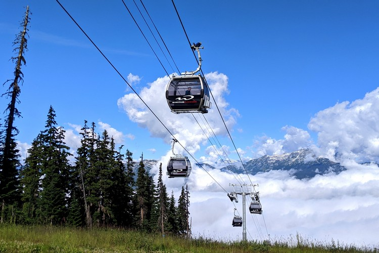 The new Blackcomb Gondola going up Blackcomb Mountain. Viewed on Whistler Jeep Tour sightseeing adventure