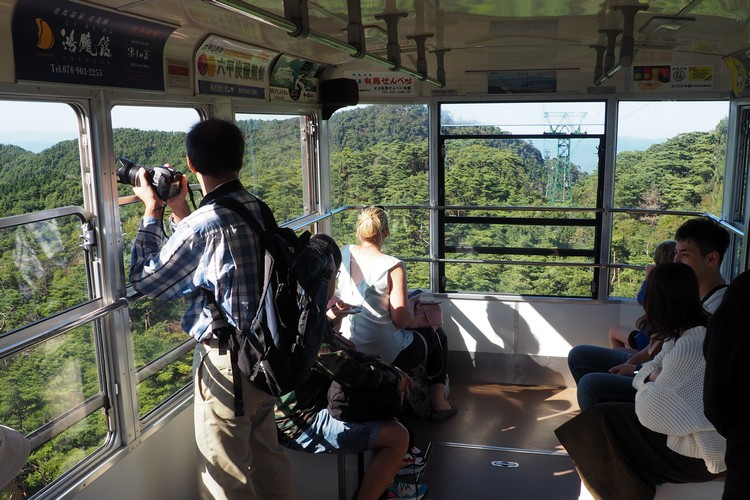 Kobe travel - Traveling down from Mount Rokko inside the tram on the Rokko-Arima Ropeway towards Arima Onsen Hot Springs