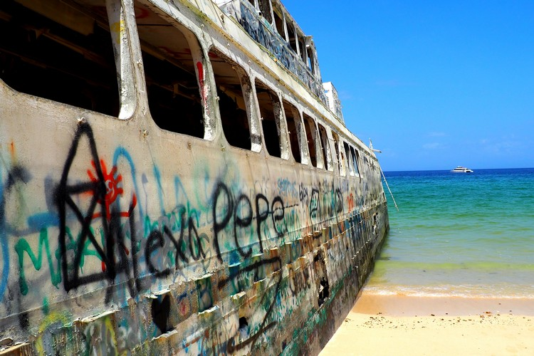 abandoned ferry on beach, broken windows and graffiti, Contadora Island