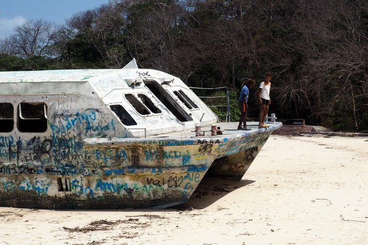 kids playing on abandoned ferry in front of Hotel Contadora Resort, Panama Pacific Island