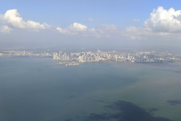 aerial view of Panama City skyline from inside airplane on Copa Airlines Business Class