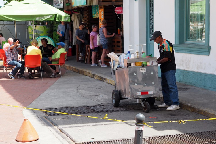 Street vendor selling shaved ice to tourists in Casco Veijo. This is a popular drink/dessert in Panama.