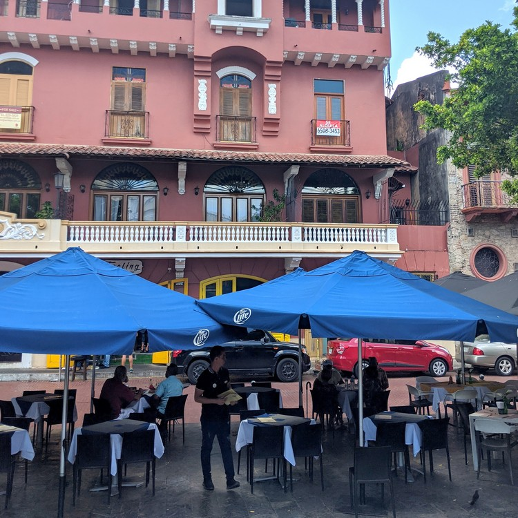 Outdoor patio restaurant at Plaza Simón Bolívar square in Casco Viejo Old Quarter of Panama City, Panama