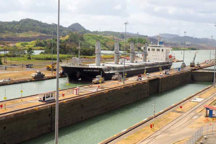 big cargo ship enters Miraflores Locks on the Panama Canal in Panama City