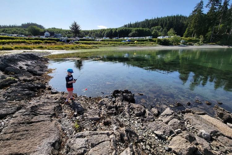 kid fishing at Alder Bay RV campground Vancouver Island, British Columbia