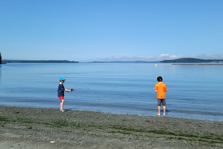 kids fishing on the beach at Alder Bay RV Park on Vancouver Island, British Columbia
